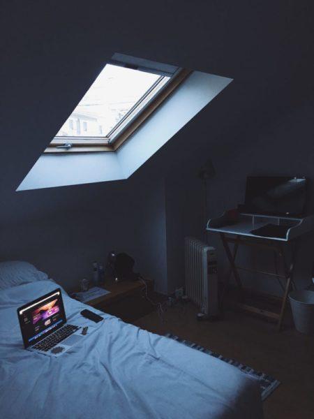 black laptop on bed
